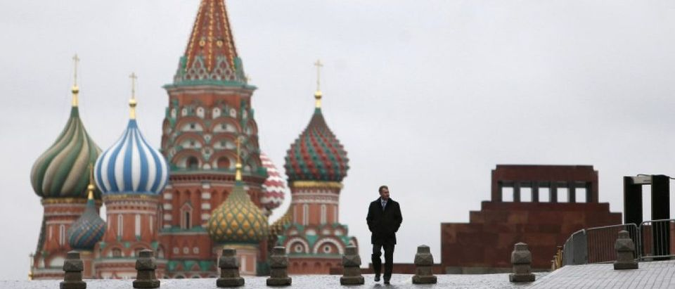FILE PHOTO: A man walks along Red Square in Moscow