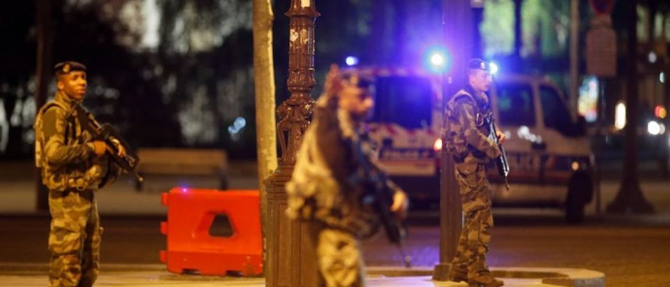 Armed soldiers secure the Champs Elysees Avenue after two policemen were killed and another wounded in a shooting incident in Paris