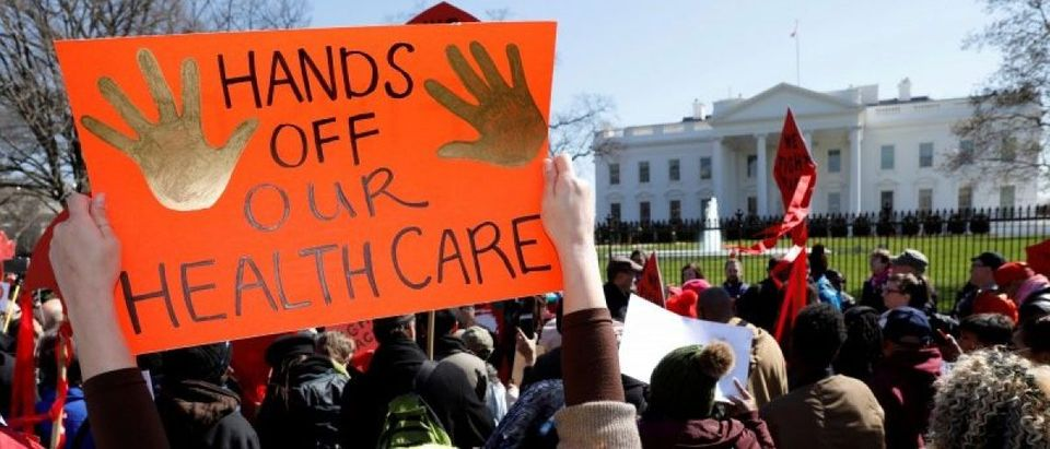 FILE PHOTO: Healthcare demonstrators protest at the White House in Washington