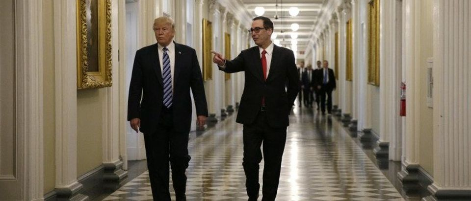 U.S. President Trump arrives with Treasury Secretary Mnuchin prior to signing financial services executive orders at the Treasury Department in Washington