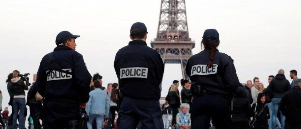 Police patrol at the Trocadero near the Eiffel Tower after a policeman was killed and two others were wounded in a shooting incident in Paris