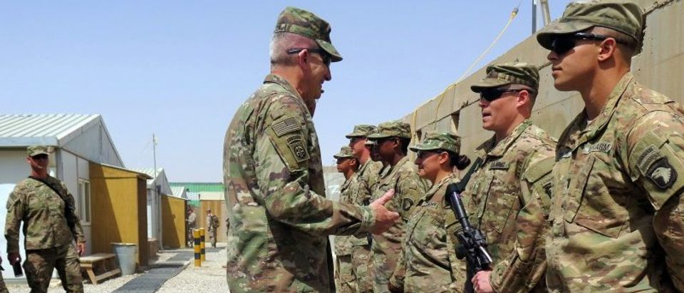 U.S. Army General John Nicholson, commander of Resolute Support forces and U.S. forces in Afghanistan, talks to U.S. soldiers during a transfer of authority ceremony at Shorab camp
