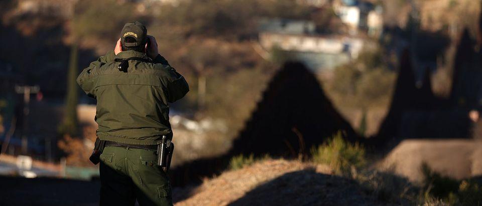 U.S. Border Patrol Agent David Ruiz patrols the U.S. border with Mexico in Nogales