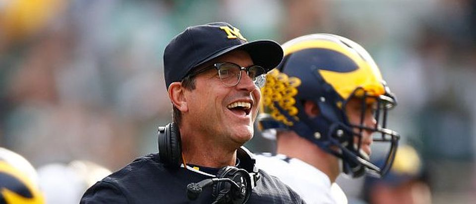 Head coach Jim Harbaugh reacts on the sidelines while playing the Michigan State Spartans at Spartan Stadium on October 29, 2016 in East Lansing, Michigan. Michigan won the game 32-23. (Photo by Gregory Shamus/Getty Images)