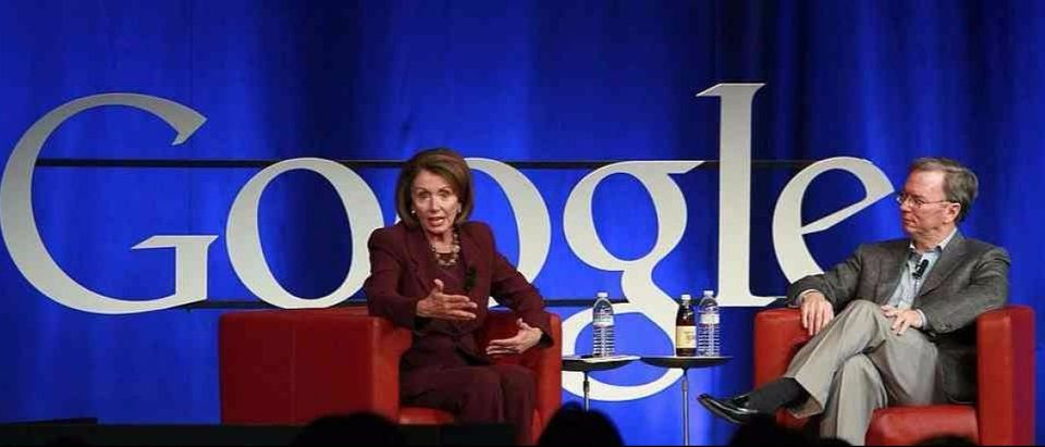 MOUNTAIN VIEW, CA - OCTOBER 27: Google CEO Eric Schmidt (R) and U.S. Speaker of the House Nancy Pelosi (L) speak during a conversation October 27, 2008 at Google headquarters in Mountain View, California. Pelosi and Schmidt engaged in a conversation and answered questions as part of the Google speaker series. (Photo by Justin Sullivan/Getty Images)