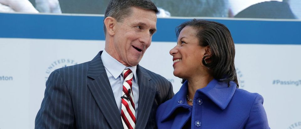 White House National Security Adviser Susan Rice and former Defense Intelligence Agency Director retired Army Lt. Gen. Michael Flynn, incoming White House national security adviser, shake hands, in Washington