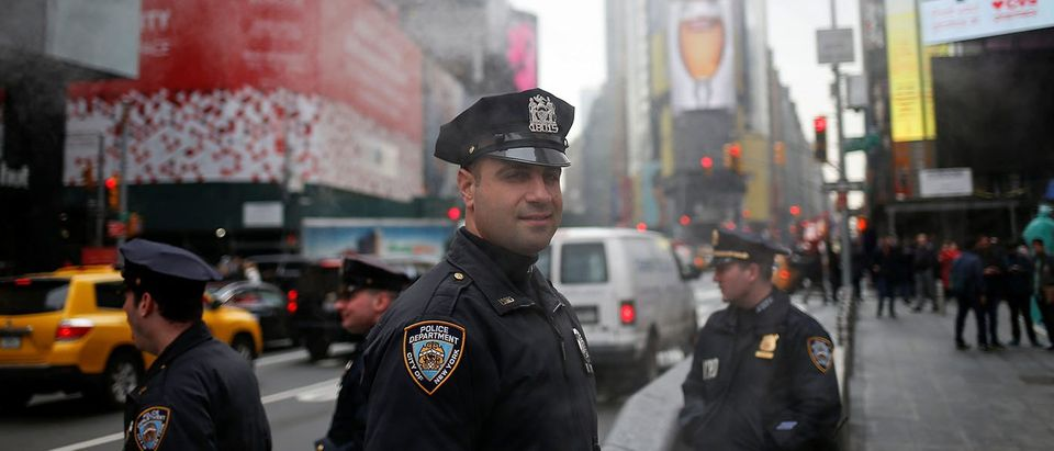 NYPD officers stand guard in Times Square, New York