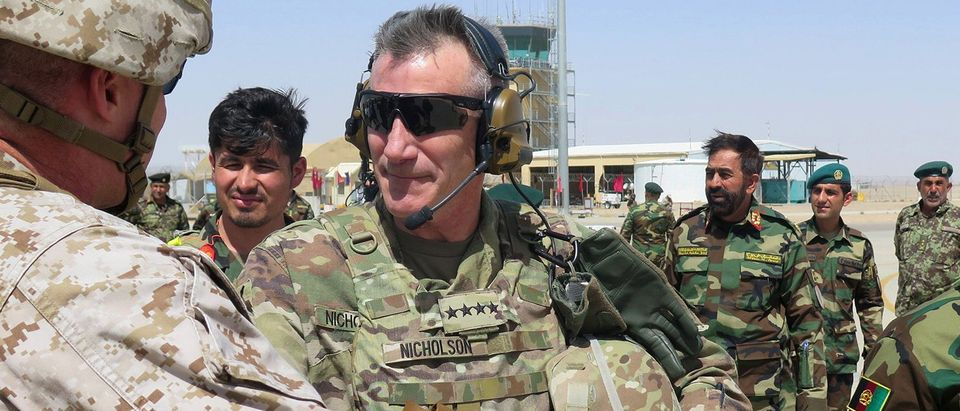 U.S. Army General John Nicholson, commander of Resolute Support forces and U.S. forces in Afghanistan, arrives during a transfer of authority ceremony at Shorab camp