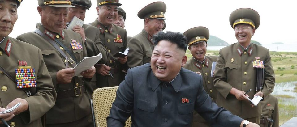 North Korean leader Kim Jung Un guides the test fire of a tactical rocket in this undated photo