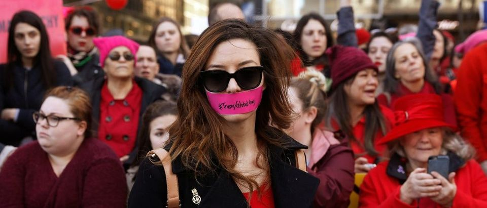 A woman with tape over her mouth REUTERS/Lucas Jackson