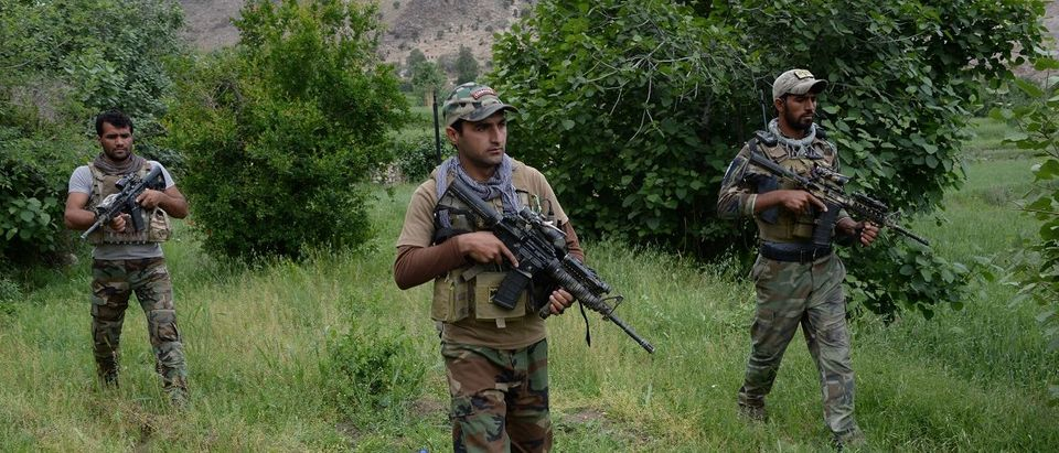 Afghan commando forces patrol at the site of US bombing in the Achin district of Nangarhar province on April 23, 2017. Afghan authorities April 15 reported a jump in fatalities from the American military's largest non-nuclear bomb, declaring some 90 Islamic State fighters dead, as US-led forces conducted clean-up operations over their mountain hideouts. Noorullah Shirzada/AFP/Getty Images.