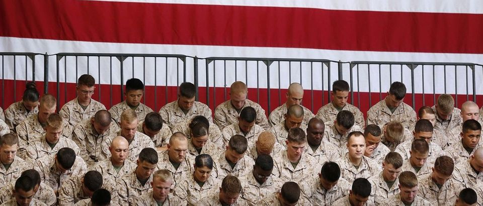 U.S. Marines pray before the arrival of U.S. President Barack Obama at Marine Corps Base-Camp Pendleton in California