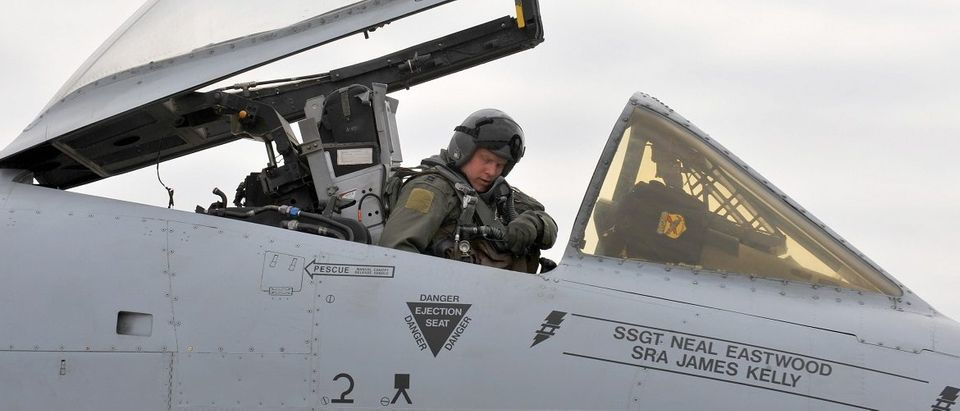 A US Air Force pilot sits in the cockpit