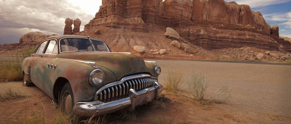 Old Car rusting away in the desert