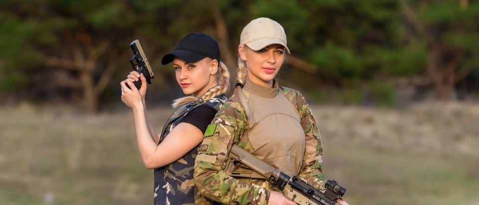 Women are standing firearms. (Shutterstock/Olexandr Taranukhin)