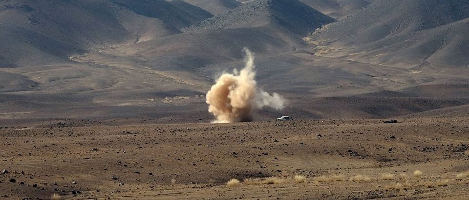Dust rises from the site of a rocket strike at a range where Afghan troops practiced coordinating air strikes during an exercise outside Kabul