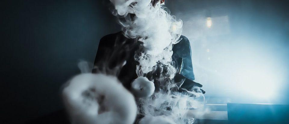 A man creates a vape cloud. Losev Artyom/Shutterstock.