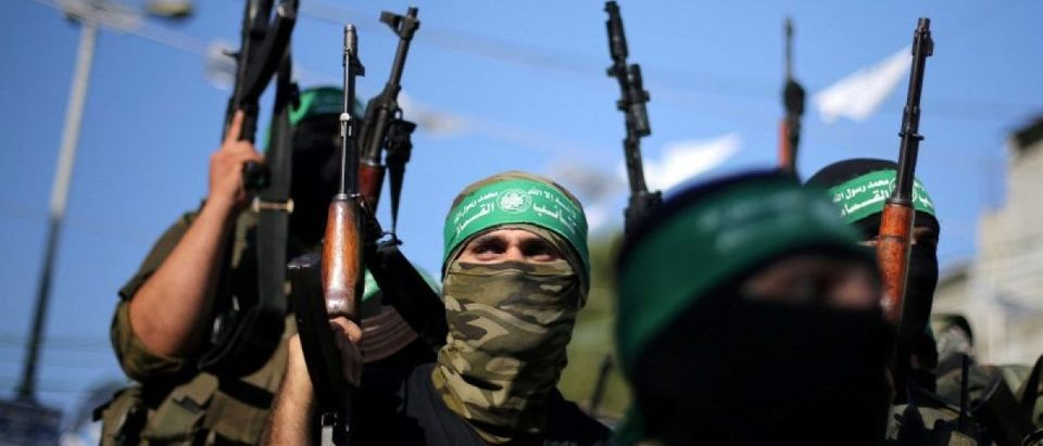 FILE PHOTO: Hamas militants hold weapons as they celebrate the release of Palestinian prisoner Mohammed al-Bashiti, in Rafah, July 2016