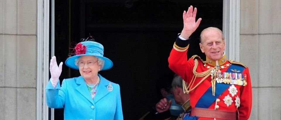 FILE PHOTO - File photo of Britain's Queen Elizabeth and Prince Philip waving from the balcony of Buckingham Palace after attending the Trooping the Colour ceremony in London