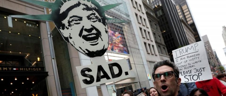 Protesters demonstrate near Trump Tower against U.S. President Donald Trump in the Manhattan borough of New York City