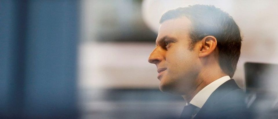 Emmanuel Macron, head of the political movement En Marche !, or Onwards !, and candidate for the 2017 presidential election, is pictured through a window of his hotel during a campaign visit in Rodez