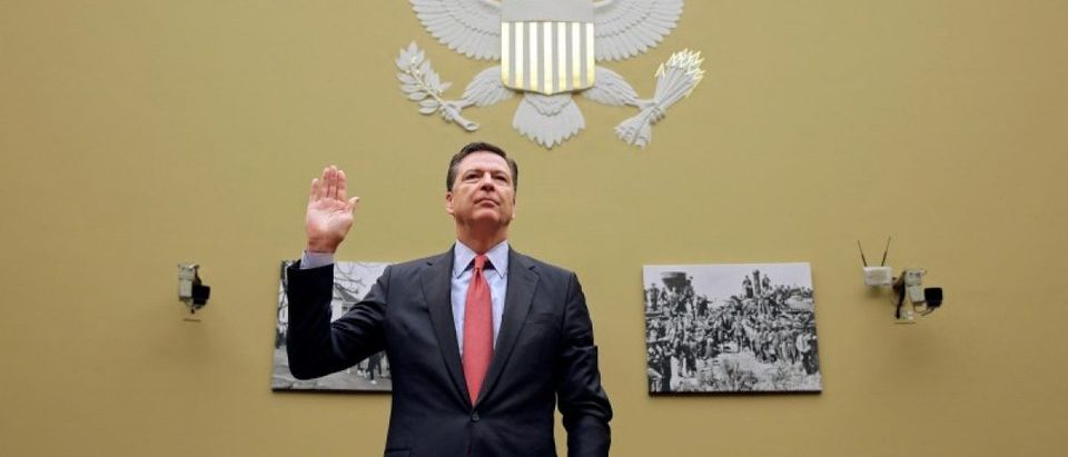 FILE PHOTO: FBI Director Comey is sworn in before testifying on Capitol Hill in Washington