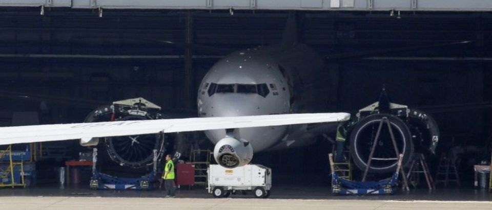 A new Boeing 737MAX sits parked in a hangar at Boeing Field in Seattle