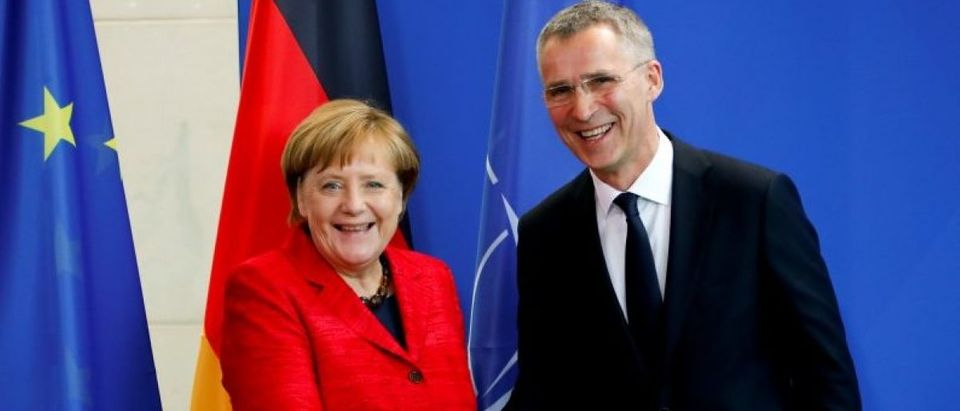 German Chancellor Angela Merkel and NATO Secretary-General Jens Stoltenberg shake hands after a news conference following their talks in Berlin