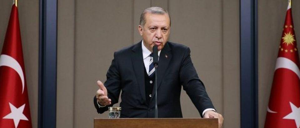 Turkish President Erdogan speaks during a news conference at Esenboga International airport in Ankara