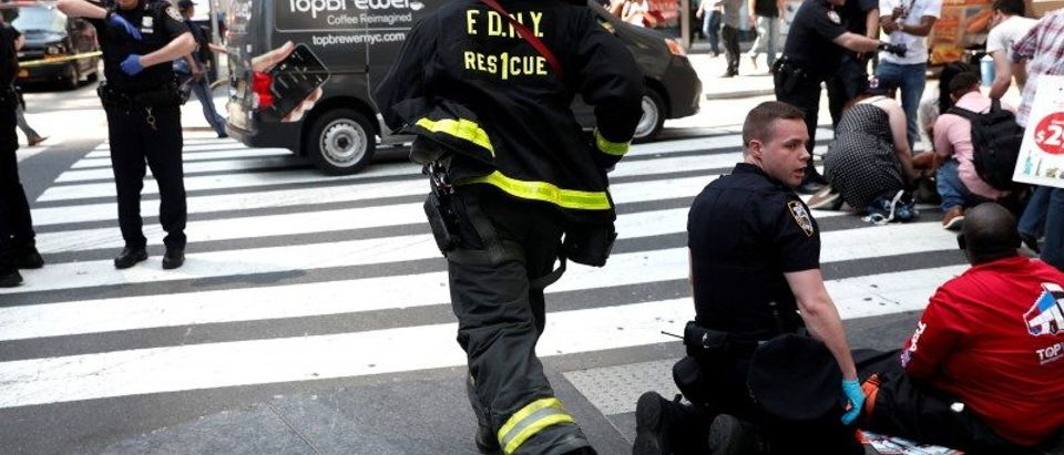 A New York City Fire Department (FDNY) emergency worker rushes to a scene in Times Square after a speeding vehicle struck pedestrians on the sidewalk in New York City