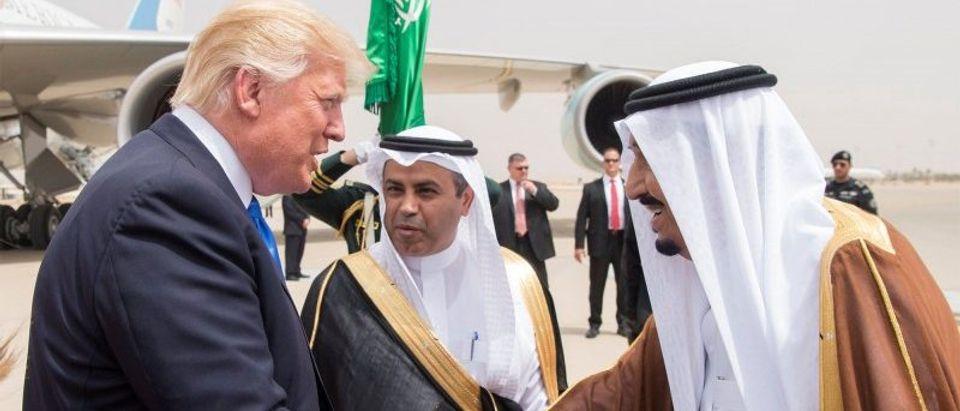 Saudi Arabia's King Salman bin Abdulaziz Al Saud shakes hands with U.S. President Donald Trump during a reception ceremony in Riyadh