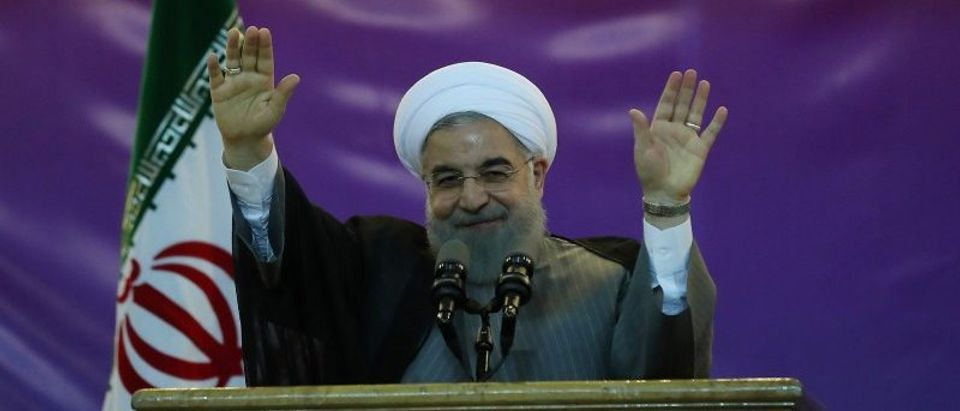 Iran's President Hassan Rouhani gestures during a ceremony celebrating International Workers' Day, in Tehran