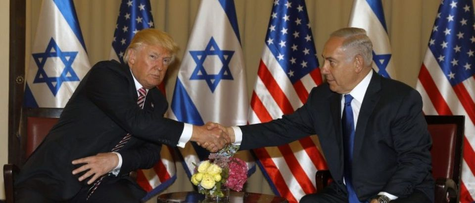 U.S. President Donald Trump shakes hands with Israeli Prime Minister Benjamin Netanyahu during their meeting at the King David Hotel in Jerusalem