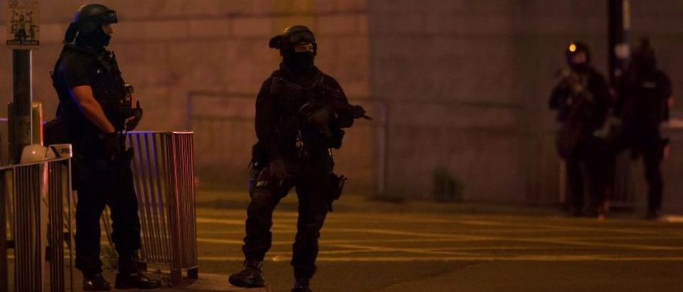 Armed police officers stand outside the Manchester Arena, where U.S. singer Ariana Grande had been performing in Manchester, northern England, Britain