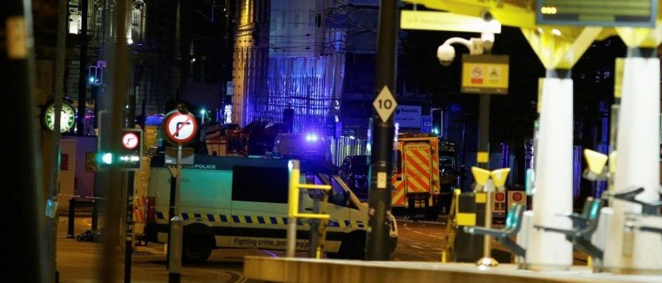 A police vehicle is seen outside the Manchester Arena, where U.S. singer Ariana Grande had been performing in Manchester, northern England, Britain