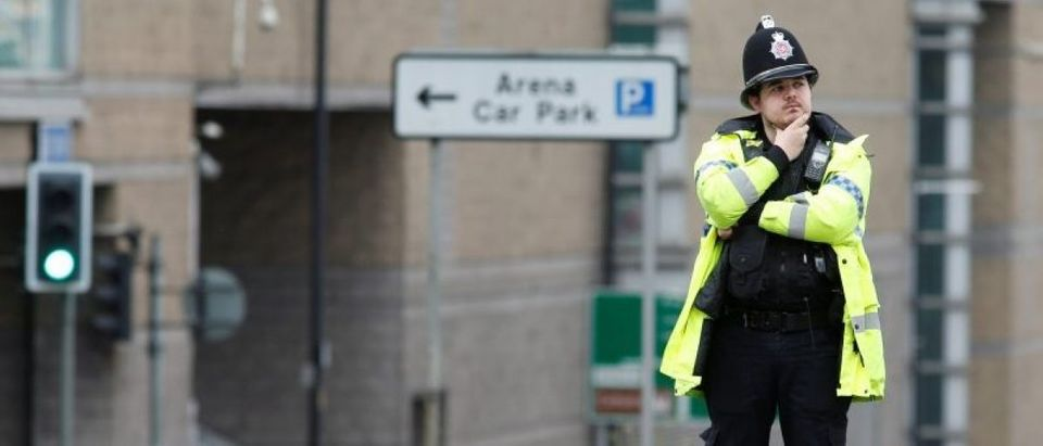 A police officer stands near the cordon around the Manchester Arena