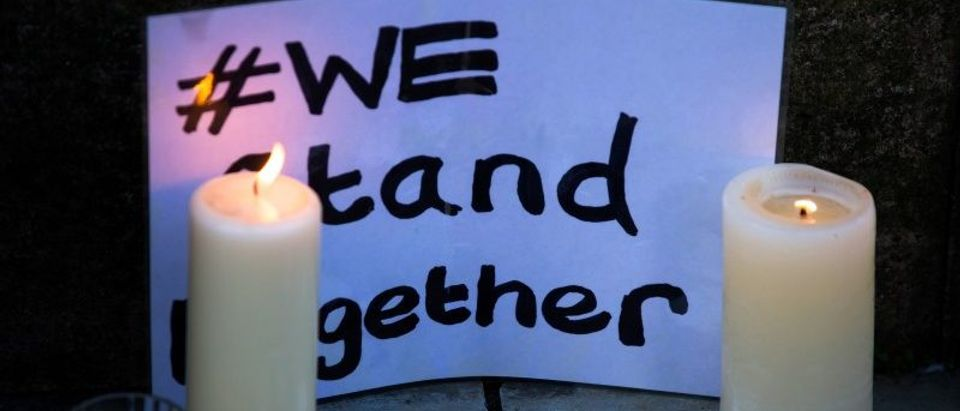 Candles and a message of condolence are left for the victims of the Manchester Arena attack in central Manchester, Britain