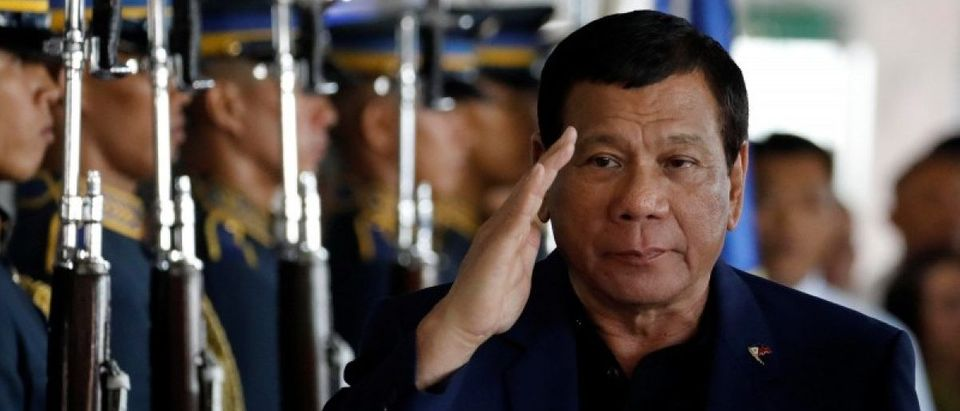 Philippine President Rodrigo Duterte salutes the honor guards upon arrival from Russia at the Ninoy Aquino International airport in Paranaque, Metro Manila