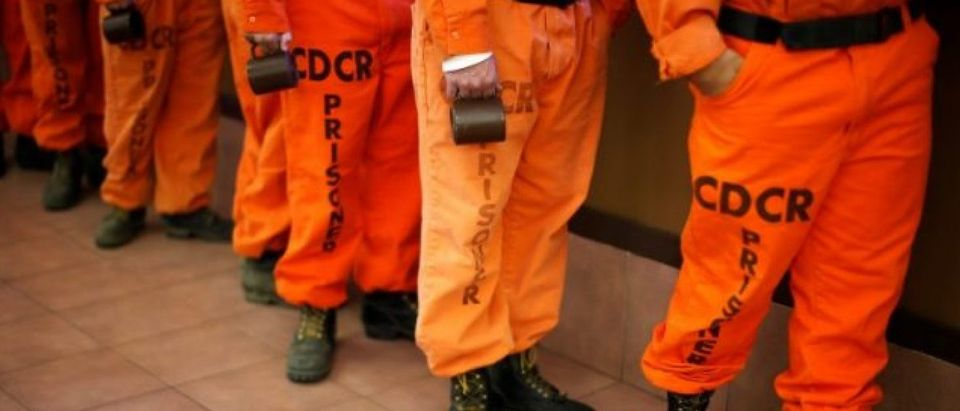 FILE PHOTO: Prison inmates wearing firefighting boots line up for breakfast at Oak Glen Conservation Fire Camp #35 in Yucaipa