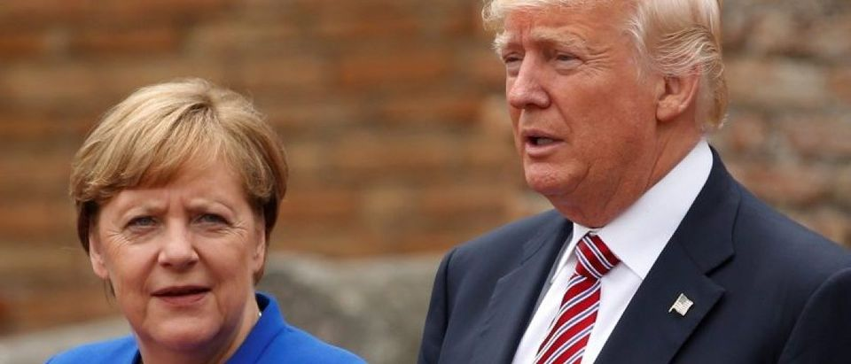 U.S. President Donald Trump and German Chancellor Angela Merkel pose during a family phto at the Greek Theatre during a G7 summit in Taormina