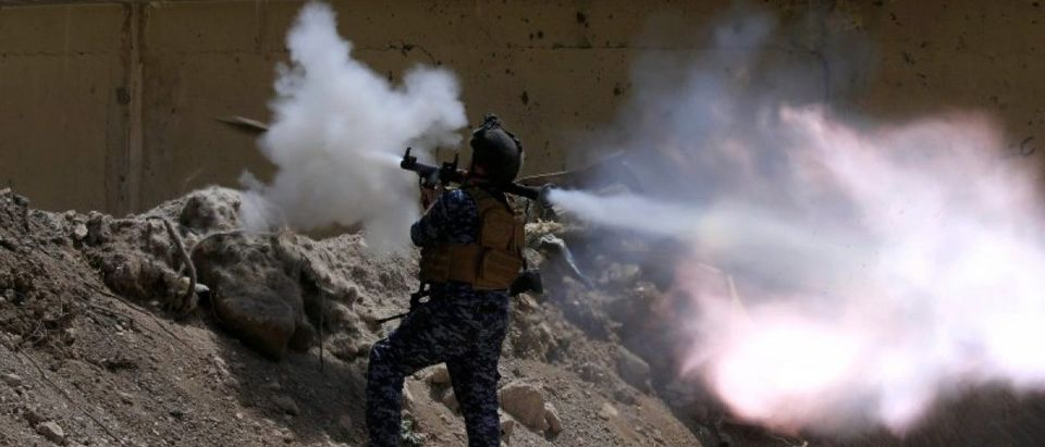 An Iraqi Federal Police member fires an RPG towards Islamic State militants during a battle in western Mosul