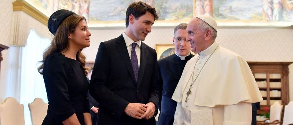 Pope Francis exchanges gifts with Canada's Prime Minister Justin Trudeau and his wife Sophie Gregoire Trudeau during a private audience at the Vatican