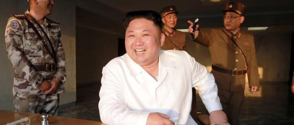 North Korean leader Kim Jong Un reacts during a ballistic rocket test-fire through a precision control guidance system in this undated photo released by North Korea's Korean Central News Agency