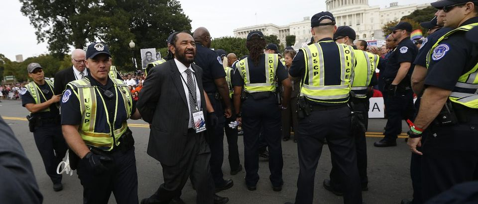 U.S. Rep. Al Green (D-TX) is detained during a protest calling for comprehensive immigration reform outside the U.S. Capital Building in Washington