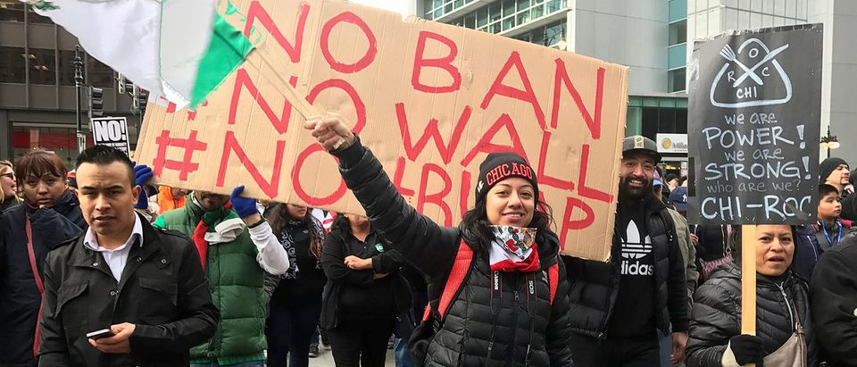 """Demonstrators march during the """"Day Without Immigrants"""" protest in Chicago"""