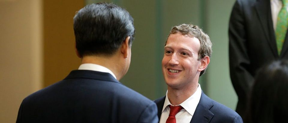 Chinese President Xi Jinping, left, talks with Facebook Chief Executive Mark Zuckerberg, right, during a gathering of CEOs and other executives at Microsoft's main campus September 23, 2015 in Redmond, Washington. Xi and top executives from U.S. and Chinese companies discussed a range of issues, including trade relations, intellectual property protection, regulation transparency and clean energy, according to published reports. (Photo by Ted S. Warren-Pool/Getty Images)