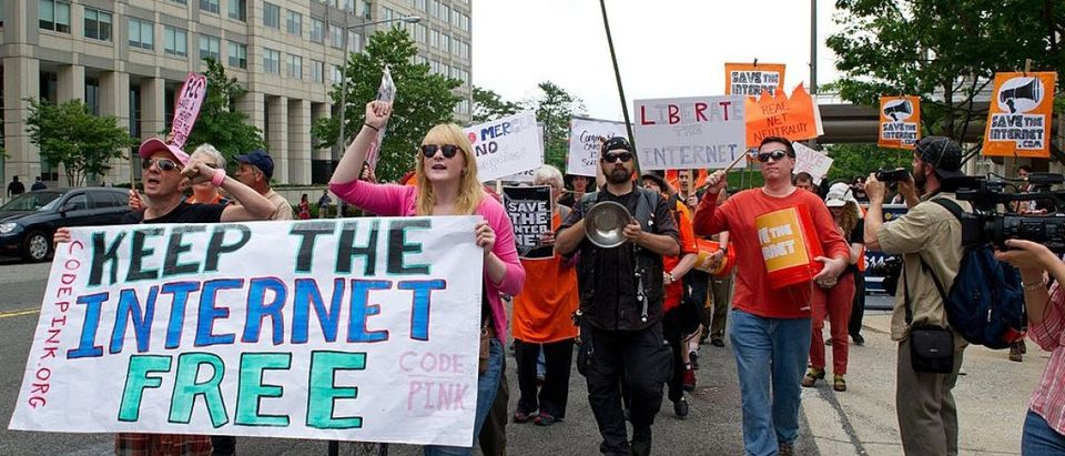 "Protesters hold a rally to support ""net neutrality"" and urge the Federal Communications Commission (FCC) to reject a proposal that would allow Internet service providers such as AT&T and Verizon ""to boost their revenue by creating speedy online lanes for deep-pocketed websites and applications and slowing down everyone else,"" on May 15, 2014 at the FCC in Washington, DC. The FCC commissioners voted on a proposal for protecting an open Internet. (Photo credit: KAREN BLEIER/AFP/Getty Images)"