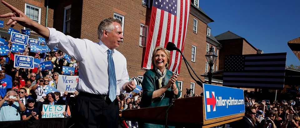 Clinton is introduced by McAuliffe as she takes the stage for a rally with grassroots supporters in Alexandria, Virginia