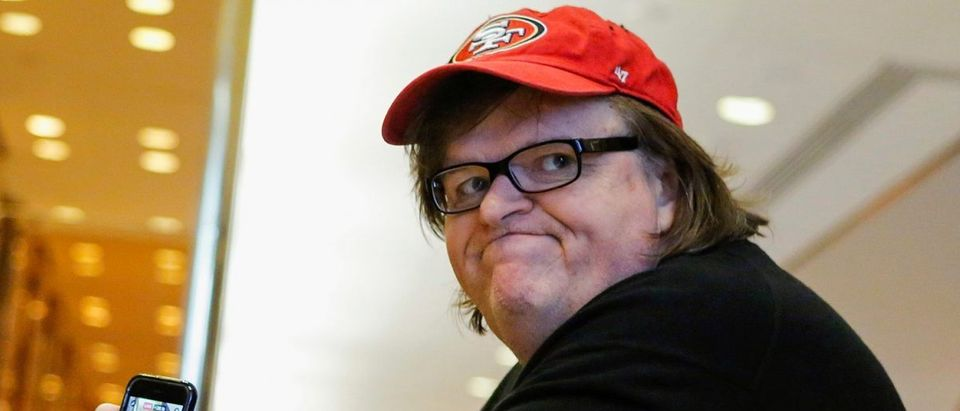 Filmmaker Michael Moore arrives at Republican president-elect Donald Trump's Trump Tower in New York