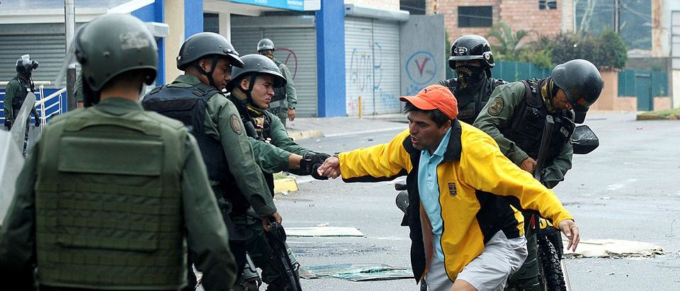 A demonstrator is detained by riot security forces during a protest against Venezuelan President Nicolas Maduro's government in San Cristobal